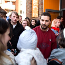 Picture Of Transformers actor Shia LaBeouf greets fans as he finishes 24hr lift stunt