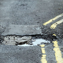 Picture Of 16,000 potholes reported across Greater Manchester in ONE year